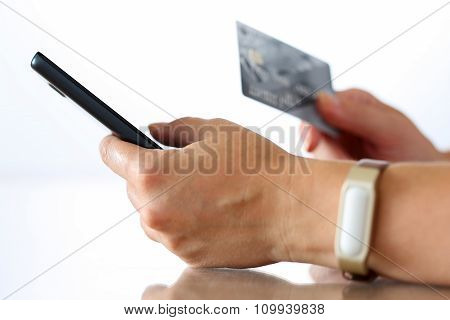 Female Hands Holding Credit Card And Making Online Purchase Usin