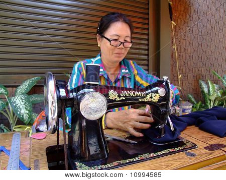 Woman sewing in Thailand.