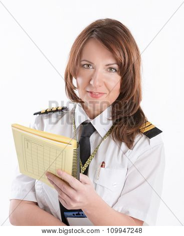 Beautiful woman pilot wearing uniform with epaulets with papers