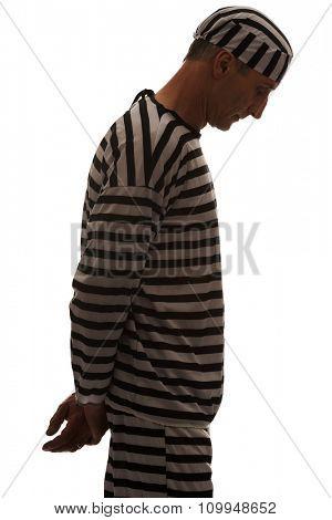 Mature sad man prisoner in striped clothes.