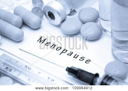 Menopause - diagnosis written on a white piece of paper. Syringe and vaccine with drugs. poster