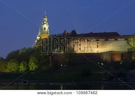 Poland Krakow Wawel Royal Castle Lit-up spring evening seen from the west poster