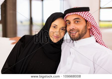 cute young muslim married couple relaxing at home