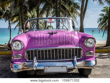 Pink Classic Car Parked Near The Beach In Cuba Frontview