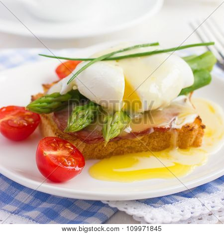 Eggs Benedict With Hollandaise Sauce On Toast With  Bacon And Asparagus