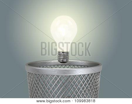 Eureka; Concept Of The Reborn Of Idea;  Glowing Light Bulb Under The Bin