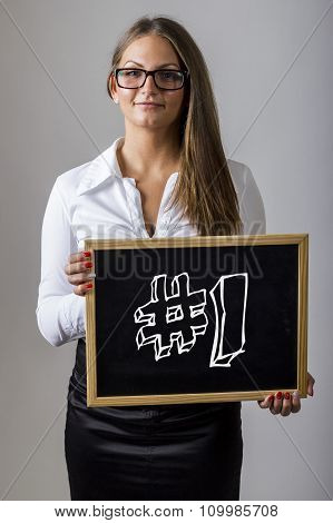 Number 1 - Young Businesswoman Holding Chalkboard With Text