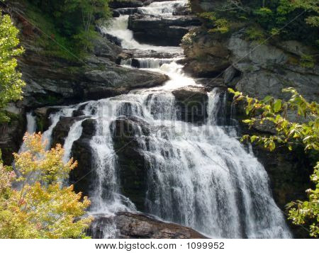 the cullsaja waterfall drops 250 feet into a beautiful gorge and is found in western north carolina poster