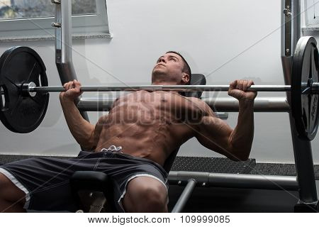 Young Man Working Out Chest