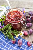 Homemade preserves: a delicious plum jam . poster
