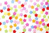 colored stars confetti on white background. close-up poster