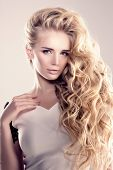 Model with long hair Blonde Waves Curls Hairstyle Hair Salon Updo Fashion model with shiny hair Woman with healthy hair girl with luxurious haircut Hair loss Girl with hair volume lights  poster