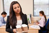 Fed Up Female Intern Fetching Coffee In Office poster