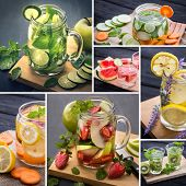 Fresh fruit Flavored infused water mix of fruits slices and water. poster