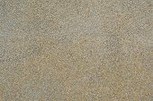 Pebble Wash finish with rough texture surface of exposed aggregate finish. Ground stone washed floor, made of small sand stone in light brown colour poster