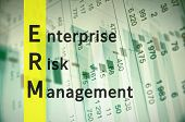 Acronym ERM as Enterprise risk management. Financial data on the background. poster