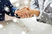 people, homosexuality, same-sex marriage and love concept - close up of happy male gay couple hands with wedding ring on and little box on table over snow effect poster