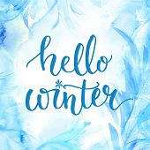 Hello winter banner with lettering, brush script at blue watercolor frosty background. Winter season cards, december greetings for social media. Vector calligraphy. poster