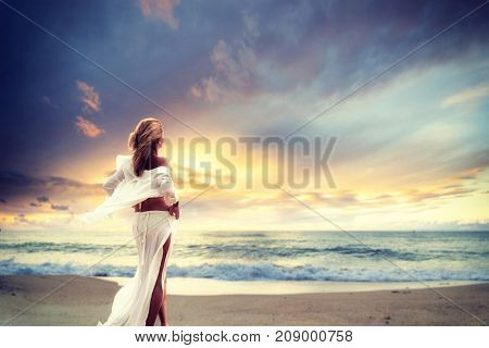 Woman on the beach at sunset in south east Asia