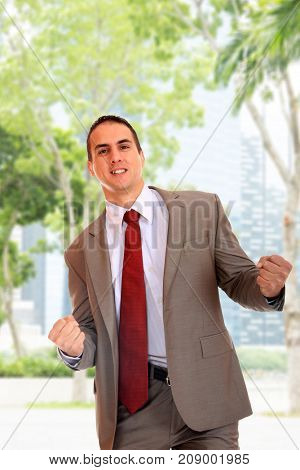 Businessman in suit over singapore city background
