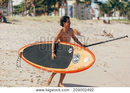 Cabedelo, Paraiba, Brazil - October 15, 2017 - Stand Up Paddle Boarding On Brazilian Beach
