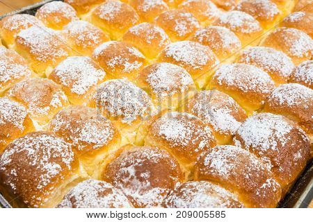 Freshly Hot Baked Butter Bread On Tray Sprinkle With Icing Sugar