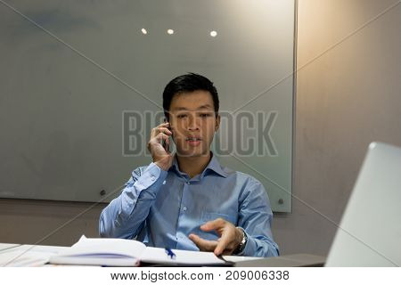 Business employee talking on phone with customer