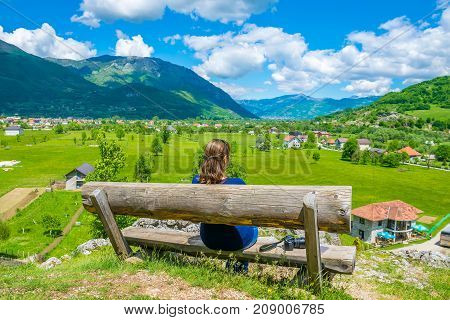 A Young Girl Dreams On A Wooden Bench Near The Sources Of Ali Pasha.