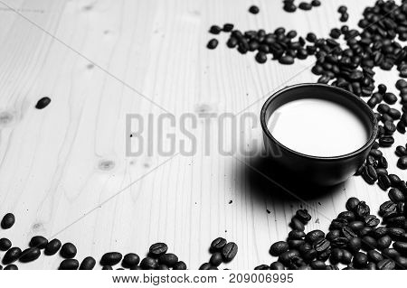 coffee beans on the table black and white poster
