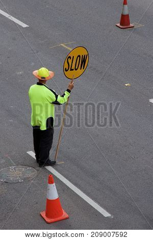 Traffic warden controlling vehicles on a road, Newcastle, NSW Australia