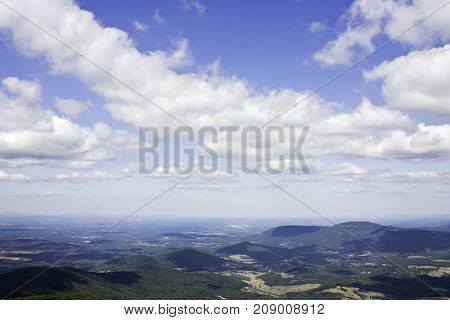 Wide panoramic view of the beautiful landscape valleys and mountains of Shenandoah National Park, Virginia on a sunny, cloud filled late afternoon in September.