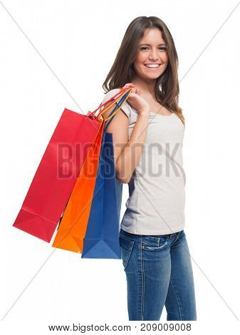 Young woman holding shopping bags, isolated on white