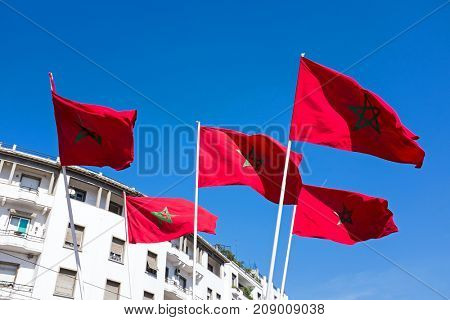 Moroccan flags against a blue sky in Morocco
