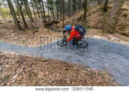 Cycling in autumn mountains forest landscape. Man cycling MTB enduro flow trail track. Outdoor sport activity.