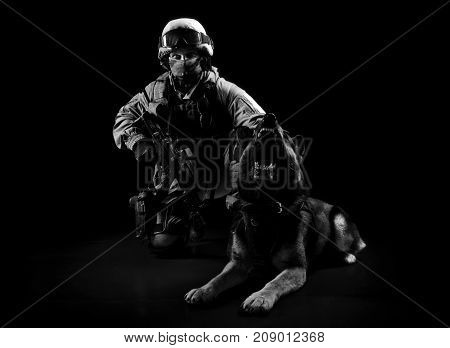 Armed Man In Military Uniform Sits Next To A Search Dog