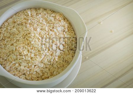 The Oats Rice In White Bowl On Top Table Wood Worm Tone Image