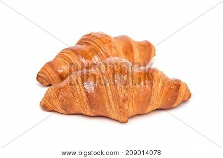 Two fresh croissant isolated on a white background