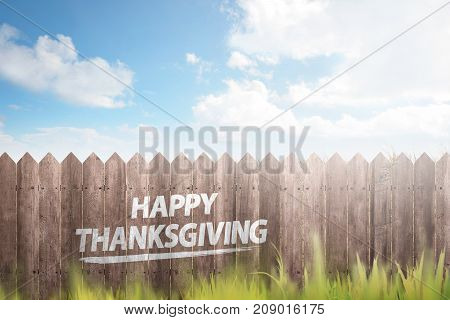Green Grass And Wooden Fence With Text Happy Thanksgiving