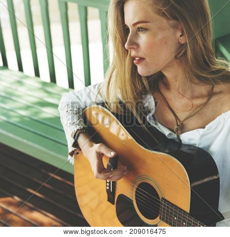 Beautiful country girl with her guitar