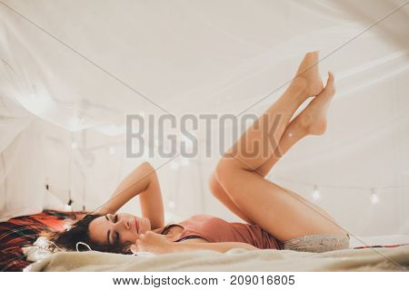beautiful woman on the bed, christmas interior