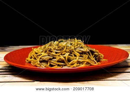 fried beef noodle food on the table