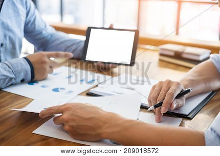 Businessman Presenting Something At The Seminar Using Tablet At The Office , Audit Concept At Workin