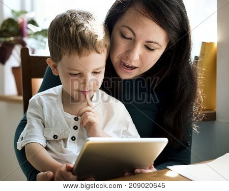 A mother teaching her son his assignment