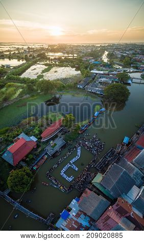 On Dec 42016. At twilight. The people of Phak-Hai Ayutthaya Thailand. Gather for a dedication ceremony of mourning the death of His Majesty the King Bhumibol Adulyadej. People card stunts by boat on river. Mean