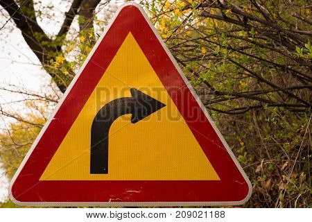 Detailed close up of curvy road sign