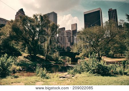 Central Park Spring with skyline in midtown Manhattan New York City