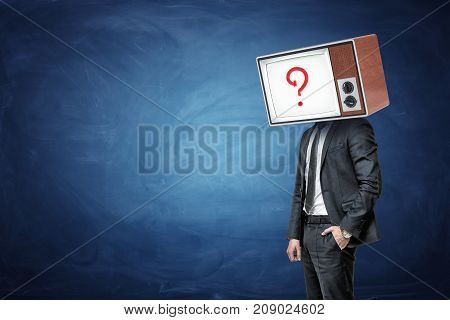 A businessman has one hand in a pocket and a head replaced by an oil TV with a question mark on the screen. Business challenges. Problems and solutions. Traditional and innovative approach.