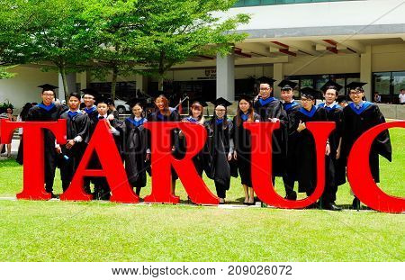 Setapak Kuala Lumpur Malaysia. August 27 2017:Beautiful young graduates with diplomas standing in front of Tunku Abdul Rahman Universiti College (TARUC).TARUC is a leading public university in Malaysia.