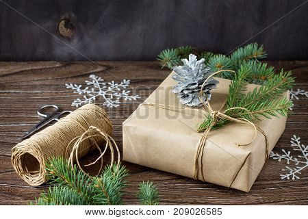 Christmas Gift Box. Christmas Presents In Handmade Boxes On A Wooden Table.