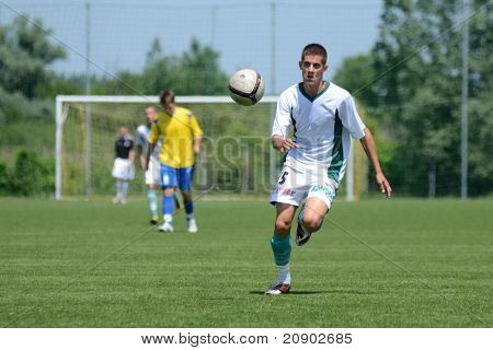 KAPOSVAR, HUNGARY - JUNE 11: Unidentified player in action at the Hungarian National Championship under 13 game between Kaposvari Rakoczi FC and Bajai LSE June 11, 2011 in Kaposvar, Hungary.